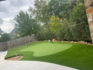 Turf mini golf course in a backyard