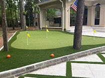 wide shot of a synthetic turf putting green