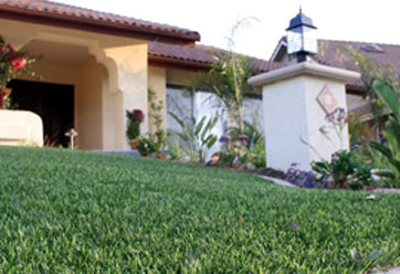 close up of synthetic turf in front of a house