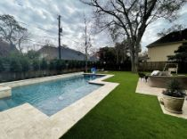 synthetic turf around a pool